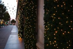 Christmas lights decorations on the street. blurred background city street with Christmas illuminations royalty free stock image