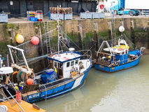 Christmas lights on fishing boats in Whitstable Harbour Royalty Free Stock Photo