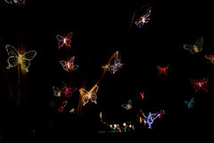 Christmas lights fly as butterflies in the night Royalty Free Stock Photo