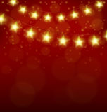 Christmas lights in form of stars on red Stock Photos