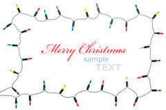 Christmas lights frame. Isolated on white background with copy space. Decorative garland Royalty Free Stock Photo