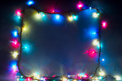 Christmas lights frame or border many colours. Christmas lights frame or border with many colours, horizontal image royalty free stock photography