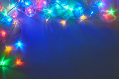 Christmas lights frame on dark blue background Royalty Free Stock Photography