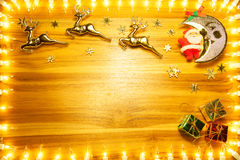 Christmas lights frame on golden wood background with copy space Royalty Free Stock Photo