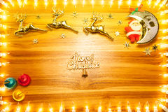 Christmas lights frame on golden wood background with copy space Stock Photo