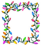 Christmas Lights Frame. Isolated on a white background as a decorated border with illuminated colourful bulbs on tangled electric wire Stock Photography
