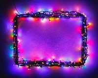 Christmas Lights Frame On Snow Background, Purple Color Royalty Free Stock Images