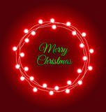 Christmas lights frame on red background. Christmas lights frame with message on red background Stock Photo