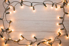 Christmas lights frame. Christmas lights  frame on a wood Royalty Free Stock Photo
