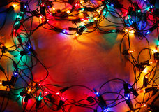 Christmas lights frame on wood background Stock Photography