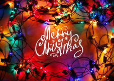Christmas lights frame on wood background with Merry Christmas Royalty Free Stock Photography