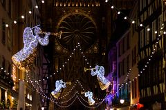 Christmas lights in front of Cathedrale Notre Dame in Strasbourg. Festive Christmas lights and decorations with blurred background in front of Chathedrale Notre royalty free stock images
