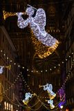 Christmas lights in front of Cathedrale Notre Dame in Strasbourg. Festive Christmas lights and decorations with blurred background in front of Chathedrale Notre royalty free stock photography