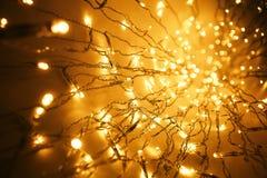 Christmas Lights Garland, Blurred Led Bulb Light Background. Yellow Lighting Bokeh Royalty Free Stock Image