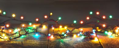 Christmas lights garland on dark background. Holiday card. Abstract pattern. Blurred pattern stock photo