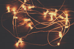 christmas lights garland on a old antique wooden parquet floor royalty free stock images - Antique Christmas Lights