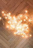 Christmas lights  garland on a old antique wooden parquet floor, Royalty Free Stock Photography