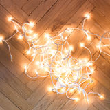Christmas lights  garland on a old antique wooden parquet floor, Stock Photography