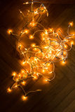 Christmas lights garland on a old antique wooden parquet floor, Royalty Free Stock Images
