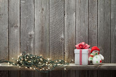 Christmas lights, gift box and snowman toy Stock Image