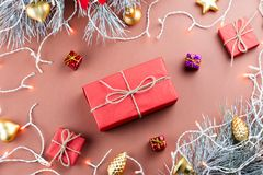 Christmas lights, giftbox, presents, golden ornaments and fir branches on brown background Royalty Free Stock Image