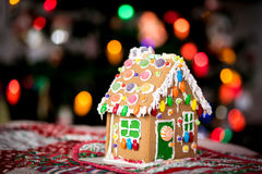 Christmas lights and a Gingerbread house. Close up Gingerbread house with Holiday lights backdrop stock photos