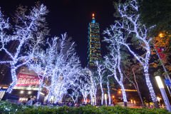 Christmas lights glow in front of the Taipei 101 building at night in the Xinyi Anhe district Royalty Free Stock Images