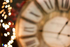 Christmas lights golden background bokeh. With clock Stock Photos