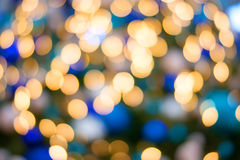 Christmas lights golden and blue bokeh. Background Stock Photo