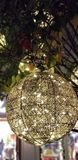 Christmas Lights - Golden Spheres anging from a tree. Golden orb of lights illuminates a tree in a shopping center in San Diego royalty free stock image