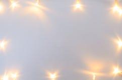 Christmas lights on gray table Stock Image