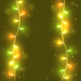 Christmas lights on green  background, bright lights Royalty Free Stock Photography