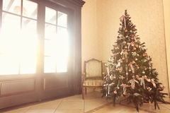 Christmas lights hanging in a tree in a restaurant room yellow pink Stock Photography