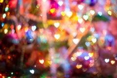 Christmas Lights Heart Bokeh. Festive background with heart shaped bokeh from Christmas tree lights glowing Stock Photography