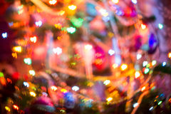 Christmas Lights Heart Bokeh. Festive background with heart shaped bokeh from Christmas tree lights glowing Stock Image