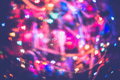 Christmas Lights Heart Bokeh. Festive background with heart shaped bokeh from Christmas tree lights glowing Royalty Free Stock Images