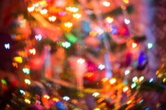 Christmas Lights Heart Bokeh. Festive background with heart shaped bokeh from Christmas tree lights glowing Stock Photo