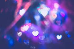 Christmas Lights Heart Bokeh. Festive background with heart shaped bokeh from Christmas tree lights glowing Royalty Free Stock Photo