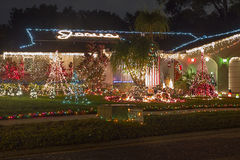 Christmas Lights. A home well decorated with Christmas lights and the name Jesus on the rooftop Royalty Free Stock Photo