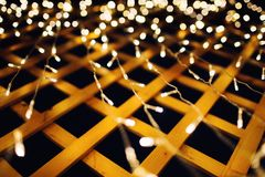 Christmas lights on house background texture in city stock photo