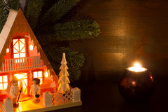 For Christmas lights house in Candlelight. With dark wooden background in rustic atmosphere stock photos