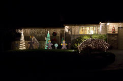 Christmas lights house home. Simple but beautiful Christmas lights at a nice house royalty free stock photos