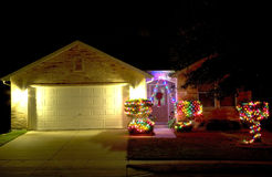 Christmas lights on house. Christmas lights and house at night background royalty free stock photos