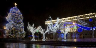 Christmas lights illuminations in the city of VArna. In front of the Appeal court palace Royalty Free Stock Photo