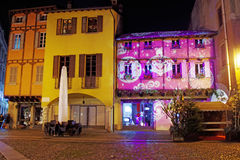 Christmas lights and images of ancient house. Christmas in Como. Ancient house illuminated with plays of lights. The play of lights on monuments and ancient stock photography