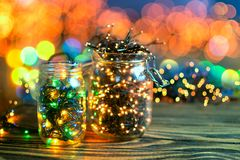 Christmas lights in a jars, concept of Christmas time, selective focus. Concept of Christmas time Stock Photos