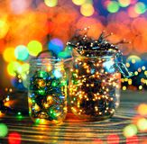 Christmas lights in jars, concept of Christmas time, selective focus. Stock Photo