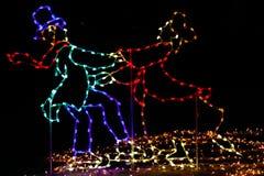 Christmas Lights - Man and Woman Ice Skating Stock Photography