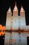 Christmas lights and mormon temple reflection. A reflection scene from temple square in salt lake city at night near christmas royalty free stock photos