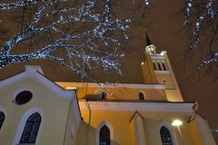 Christmas lights near St. Nicholas church. Tallinn. Estonia. Tallinn is the capital and largest city of Estonia; the Old Town is one of the best preserved stock photo
